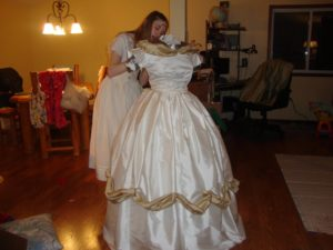 daughter putting the finishing touches on the historically accurate ballgown she designed